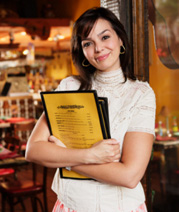 Hostess with MenuPro Menus in Menu Covers